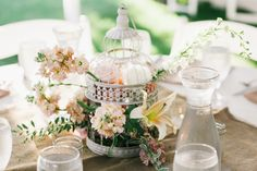 Birdcage centerpiece // photo by  Nyk + Cali Photography, see more: http://theeverylastdetail.com/charming-coral-cashmere-tennessee-wedding/