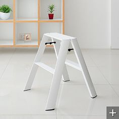 White slim line ladder...great for closet and kitchen