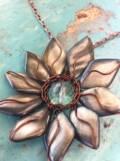 Wire wrapped shell and glass bead flower pendant