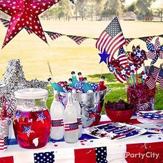 Set up a star-spangled drinks station that sparkles with our fave 4th of July decorations: shimmery 3-D stars in red, silver and blue. party favors, outdoor decorations, fanci drink, july crafts, 4th of july, holiday fourth, juli, drinks, drink stations