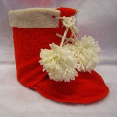 From Etsy.com.  I think thses are $10.  I  made these in high school using felt and coffee cans. For instructions and pattern google angelfire.com   coffee can santa boot.