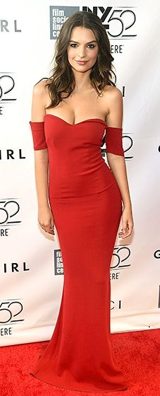 Emily Ratajkowski celebrated in a raspberry SAFiYAA gown. Long, loose curls added a romantic vibe to the sleek look.