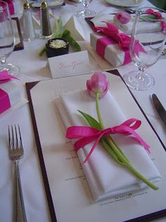 Luncheon... pink tulip wrapped with a pink grosgrain bow