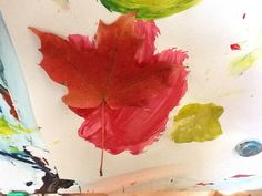Painting on easel and adding leaves