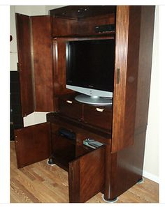 """Product: Pre-owned TV Stands  Company: eBay Green  -Save a tree of being cut down by purchasing a pre-""""loved"""" entertainment cabinet or TV stand. I will definitely do this for my apartment dorm! Saves a few trees and saves me money! So great! #greendorm"""