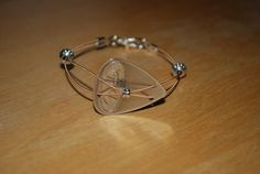 Guitar Pick and Guitar String Bracelet - Steel Pick and Bronze String with Pewter Beads - Teri