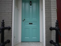painted doors, painted brick, gray + turquoise + black, great color combo for outside of house.