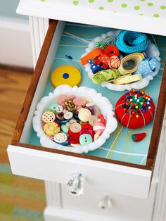 Cute little sewing drawer.