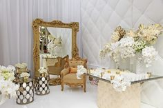 Allure Events Atelier | Booth for the 2013 Unveiled Orange County Bridal Show | Florals by Celio Designs | photographed by KLK Photography. We provided the paper flower wall, gold antique frame mirror, Paris love seat, Venice chair, London accent tables, Las Vegas dining tables and the chandeliers.