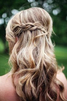 braid + waves, photo by Haley George Photography http://ruffledblog.com/handmade-south-carolina-wedding #hair #wedding