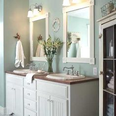 Framed Bath Mirrors - I like this framed mirror idea.  I have a piece of square mirror and I could build a frame around it and reuse somewhere in my house.