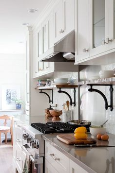 """Beautiful tile backsplash &  shelf brackets. I like the idea of the """"sitter"""" cabinet sections at the end of the upper cabinets."""