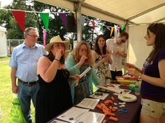 Dec 15 Manchester Branch volunteers lead visitors in carving their own carrot clarinets with which to join in with the festival acts at Jodrell Live. #science #volunteering #charity