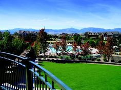 The mountains of Colorado are a backdrop to the community center and pool in the Village of Five Parks by Village Homes in Arvada, Colorado
