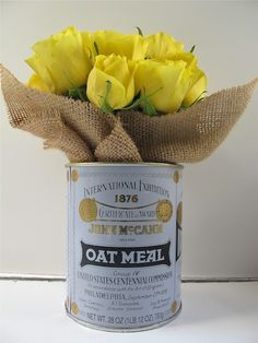 Easy DIY for you cottage look - empty a can of McCann's Irish Oatmeal.  Cut a square of burlap.  Inset burlap.  Drop in a jar of water add flowers.