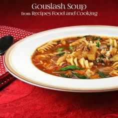 Goulash Soup has ground beef, onions, celery, peppers in a tomato garlic broth with pasta, fresh spinach and freshly grated parmesan cheese.