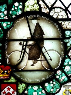 The cycling parson - The church of SS Peter & Paul - (C) Evelyn Simak