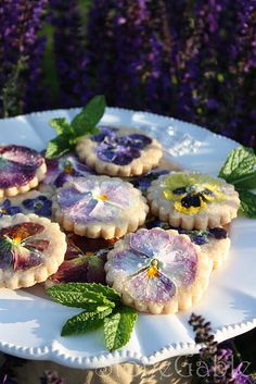 pansy shortbread cookies ... press egg washed flower on, sprinkle w sugar, bake 5 min.
