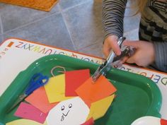 Punching holes in the turkey feathers
