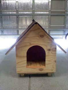 Hand built shingled dog house