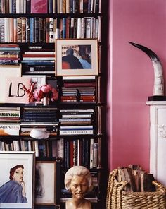 bookcase. pink walls.