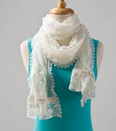 A pretty white lace and tulle scarf can dress up a plain shirt!
