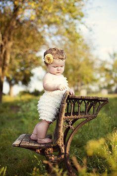 beautiful baby standing on chair