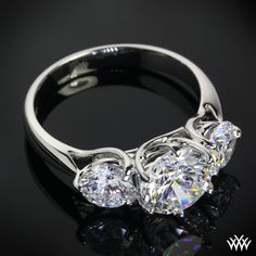 """""""Butterflies"""" 3 Stone Engagement Ring incorporates sweeping lines that twist to create one unforgettable ring. 2.00ct Round Center Stone set in Butterflies Diamond Engagement Ring"""