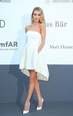 Rosie Huntington-Whiteley  in a little white strapless Dior dress and matching white pumps