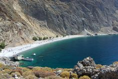 Glyka Nera, Crete, Greece Glyka Nera is also known as Sweetwater, taking its name from the springs of water that bubble under the stones at the back of the beach. It's a pebble beach backed by a towering cliff and little shade – a fantastic sun-trap.  A little taverna sells drinks and snacks and rents umbrellas. How to get there? Glyka Nera is about 25km (40 miles) from Chania and you could take a boat from Loutro (it takes about an hour) or walk from Sfakia. The walk takes about half an hour bu