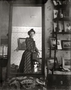 Unknown woman circa 1900 taking picture of herself in a mirror. It's the first selfie!!!!
