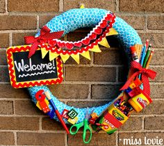 If you are artistic and looking for a cool craft project, this is a creative idea for a Back to School wreath for your classroom door.  From:  Miss Lovie