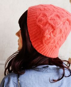A cute cable knit cap is made from an old sweater. A fun DIY holiday gift.