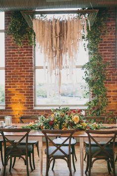 reception with hanging decor, photo by Mel Nocks Photography http://ruffledblog.com/notwedding-greenville #weddingreception #weddingdecor #weddingideas