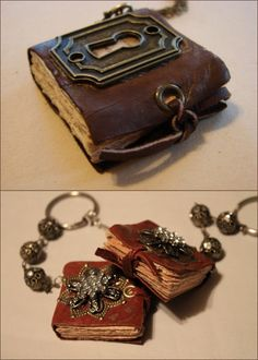 """DIY Mini Book Necklaces with Charms. I have posted 3 or 4 mini book jewelry tutorials and I keep saying, """"Oh, this is the best one."""" But this is my favorite. Clear instructions, love the grommet closures tied with leather, love the keyhole. For the tutorial and other ideas go to Art by Wendy here. I got a GC to Michaels and will get a crop-a-dile using coupons of course."""
