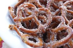 Perfect Treat for a Backyard Movie Night:) Cinnamon Sugar Pretzels 1 (16 oz) bag pretzel twists ⅔ cup vegetable oil ½ cup sugar 2 tsp cinnamon Preheat oven to 300 degrees. Pour pretzels into a roasting pan. In a medium sized bowl mix together vegetable oil, cinnamon and sugar. Pour over pretzels and stir to coat. Place in oven and bake for 30 minutes, removing twice to stir.