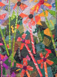 Close up, Sweet Blooms by Pat Kroth.  Photo by Quilt Inspiration.  Buttons and candy wrappers, collaged quilt.