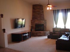 Need paint colors for living room!, Contemporary living room with stacked rock beehive fireplace. Do I go with the chocolate and blue paint colors to match the drapes or stick with tans to match the fireplace?, , Living Rooms Design