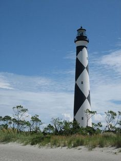 Cape Lookout Lighthouse is located on Harkers Island along the southern outer bank group of islands along the North Carolina coast. It was built in 1859 using brick and has a diamond pattern paint job to distinguish it from other lighthouses in the area for daytime use. At 163 feet the Cape Lookout Lighthouse