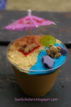 What a fun summer idea. - Pudding Cups with graham cracker crumbles/blue sugar sprinkles/graham bears, fruit roll ups (for towel), gummy lifesaver, fruit snacks for sharks and paper umbrella