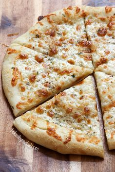 Homemade thin crust two-cheese white pizza. Recipe from @bakedbyrachel