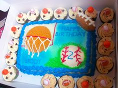 3D sports cake and with cookie dough and chocolate peanut butter cupcakes.