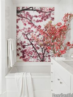 White bathroom with cherry blossoms. Design: Royce Pinkwater. #white #bathrooms