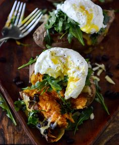 Cheesy Black Bean Stuffed Sweet Potatoes with Arugula + Poached Eggs.