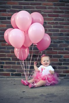 1 year pic - cute with balloons