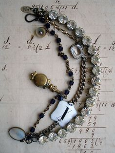 """3 Strand Bracelet with X Marks the Spot  his 3 strand bracelet has a vintage, rhinestone bracelet for strand number one. It is a prong-set strand with amazing faceted stones in tall wonderful settings. It's kind of wonderful, I must say. Strand number two is segments from 3 different goldtone watch chains interrupted by a vintage enamel clock number 10 - the """"X"""" in """"X Marks the Spot"""" title of this piece and an open back crystal link from a vintage choker..."""