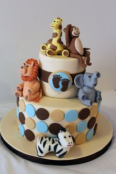 We found this adorable zoo animal cake that would go great with your zoo theme baby shower.  There are so many different animals you can use to create this fun loving baby shower party.    http://www.modern-baby-shower-ideas.com/zoo-animal-baby-shower.html