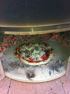 Actual pizza #1........ one minute in... Note how fast the back is already cooking.