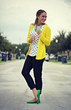 Pop of Style: black & white outfit made colorful with yellow cardigan and green accessories