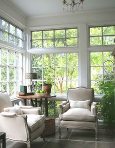 Sunroom with Belgian club chairs, a great spot for reading...floors and table too! tone on tone